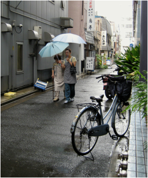 Two ladies walking in the rain